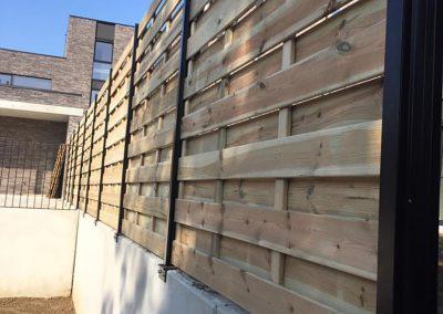 Plaatsing houten afsluiting